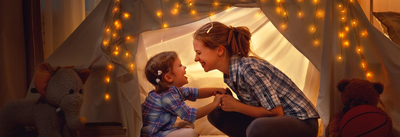 Green Homes Illinois, Child and mom in play tent, IL
