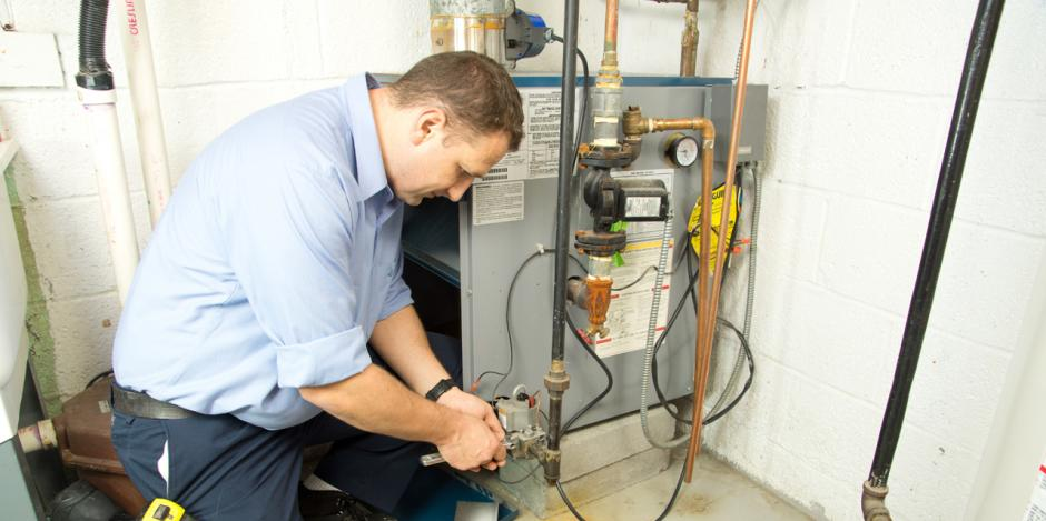 Green Homes Illinois, Technican fixing gas furnace, IL
